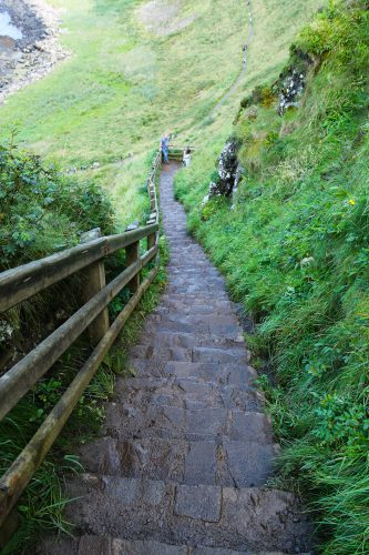rebecca gomez farrell, some who wander, giants causeway, ireland, hiking path, wet stairs